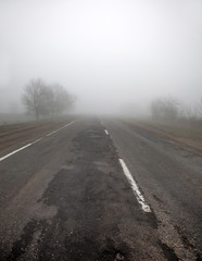 Ukrainian road in fog time.