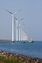 Windturbines in the Netherlands with fishing ship