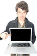 Casual Man Holding and Pointing at a Laptop Computer