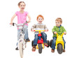 Children riding bikes and kids trikes