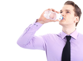 Businessman drinking refreshing water, isolated