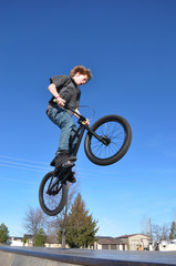 Tween Boy Flying on Bike