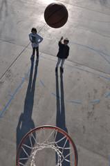 Teenage Boys Playing Basketball