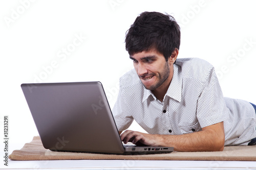 Happy young man surfing the internet