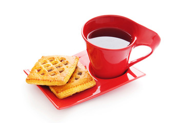 Cup of tea and fresh cookies on table