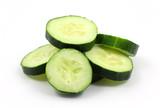 Sliced organic cucumbers on white background