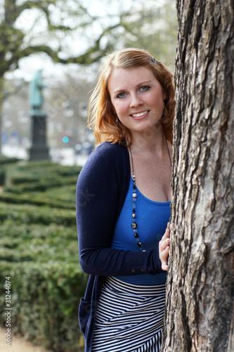 canvas print picture junge Frau im Park