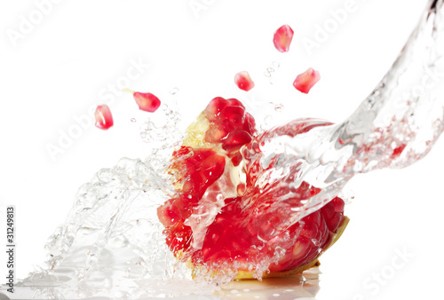 organic portuguese pomegranate splash in water-isolated on white