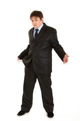 Businessman turning pocket inside out. Concept - bankruptcy.