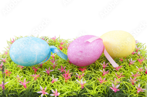 three easter eggs on grass