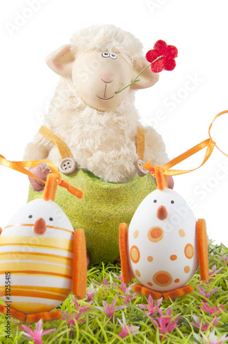 easter eggs on grass with sheep