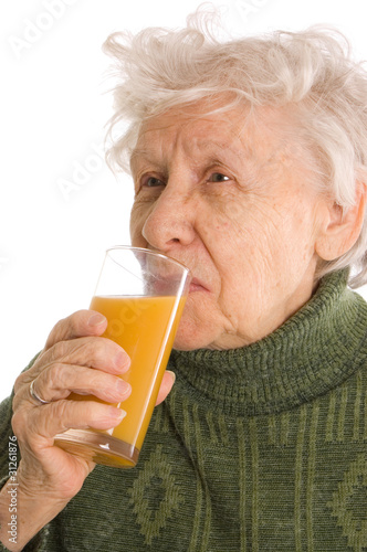The elderly woman with a juice glass