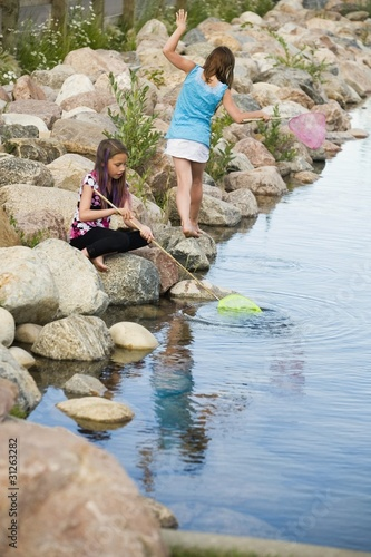 Two Girls Playing By The Water