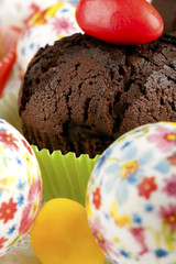 Chocolate muffin with easter eggs closeup