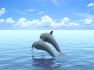 Two dolphins floating in ocean.