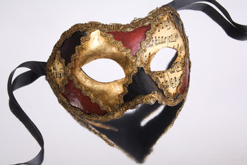 beautiful handmade venetian mask on mirror background