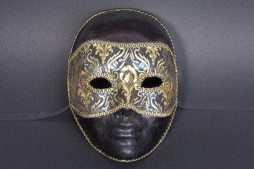 beautiful handmade venetian mask on dark blue background