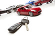 Car Keys and Several Sports Cars on White