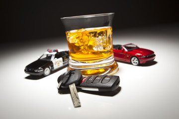 Highway Patrol Police and Sports Car Next to Alcoholic Drink and