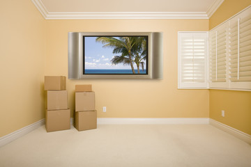 Flat Panel Television on Wall in Empty Room with Boxes