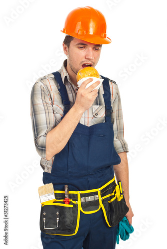 Builder man eating sandwich in a break