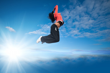 sport woman jumping and fly over sky and sun