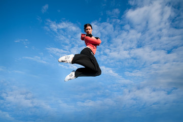 sport woman jumping and fly over sky