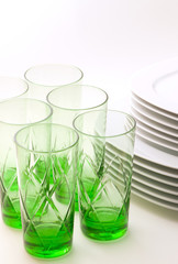 White plates and green glasses