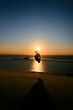 man doing backflip in sunset