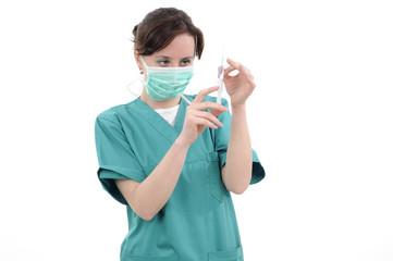 white doctor preparing syringe for vaccine