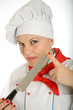 Female chef holding kitchen knife