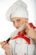 Female chef playing with a knife