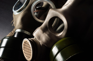 Closeup of a gasmask with enlighted background