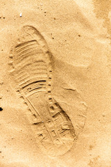 Closeup of a footprint in the sand
