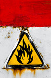 Beware of fire sign on rusty metal poster