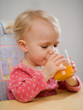 little girl with carrot juice
