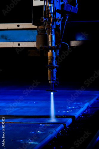 Cutting metal with CNC laser close up.