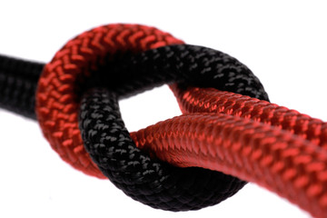 black and red ropes tighed in reef knot.