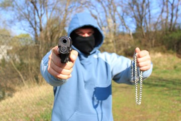 robber with a gun