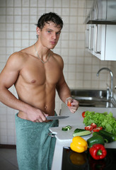 Young Muscular Man Preparing Salad