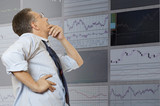 Exchange broker looks at the monitor poster