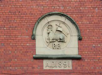 Preston city emblem on the brick wall (UK)