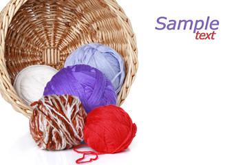 multi-colored balls of yarn in wicker basket (Copy Space)