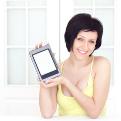young woman with ebook on a light background