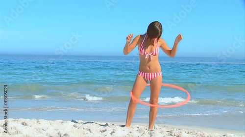 Attractive woman playing with a hoop