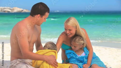 Couple drying their children on a beach