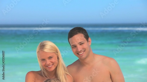 Happy family posing on a beach