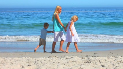 Attractive blonde woman with boy and girl walking