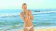 Good looking blonde woman posing on a beach