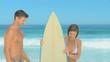 Woman meeting her boyfriend  after surfing